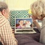 elder couple watching something on laptop